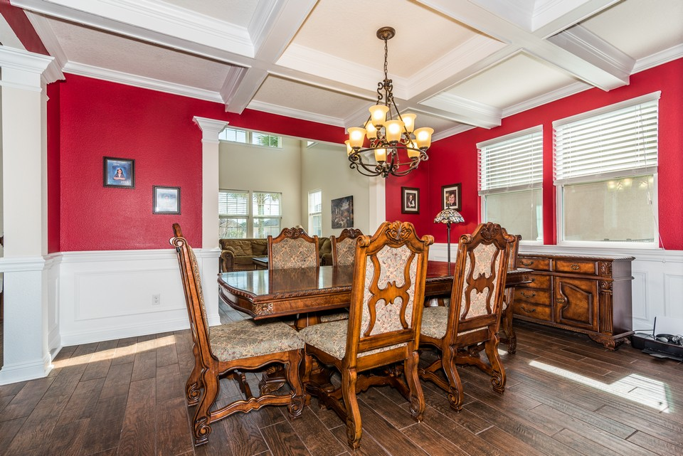 coffered ceilings and wainscot in formal dining room